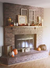 our cozy rustic chic fall red brick fireplace mantel decor falldecor fireplacedecor