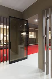 pivot door executed entirely in glass with a tinted edge salone del mobile milan system m