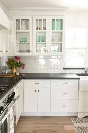 white shaker cabinetry with glass upper cabinets as