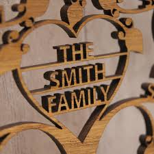 family name detail on wall art wooden tree with personalised wooden 3d heart family tree wall art by urban twist