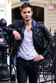 pairing up a black biker jacket with dark grey jeans and a white t shirt is a very comfortable combination when you are roaming around the city