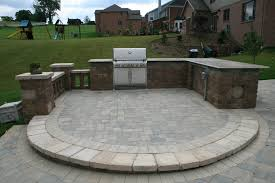 patio outdoor stone kitchen bar:  peters township outdoor kitchen area country stone built in grill bar area pillars
