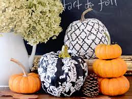 contemporary fall centerpiece featuring decoupaged patterned pumpkins