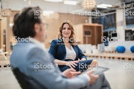 Creative office space large Glass Colleagues Sitting In Large Creative Office Space Royaltyfree Stock Photo Istock Colleagues Sitting In Large Creative Office Space Stock Photo More