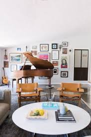 an eccentric gallery wall decorates the area in scandal star katie lowes and adam