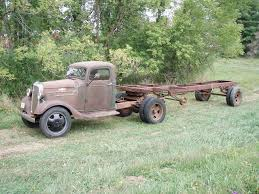 1936 chevy semi and matching fruehauf trailer tons of pics it sure looks like it belongs there there is a saw mill at the show he is going to try to guilt them into sawing the the wood for the deck of the trailer