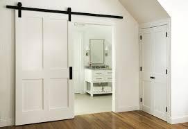 en suite bathroom with barn door on rails