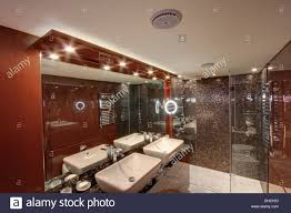 down lighting and mirror above double basins in modern bathroom in large boat moored in on the coast of southern spain bathroom down lighting
