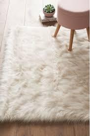 ivory faux sheepskin rug