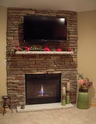 stone corner fireplace designs with tv above corner