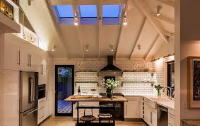 understated skylights bring in just the right amount of light design lori smyth design best lighting for sloped ceiling