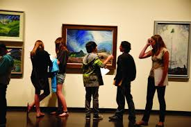 Teens looking at art