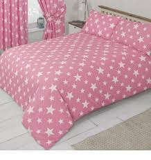 pink bedding set with a white star
