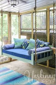 Pretty hanging bed on a screened-in back porch. Love the wrapped rope around