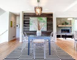 view in gallery contemporary dining room with acrylic dining tables and reclaimed wood accent wall design amek