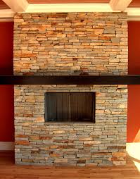 stacked stone isokern fireplaces with orange wall and natural design