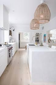kitchen lighting ikea. allwhite kitchen with a marble island and rattan pendant lights lighting ikea u