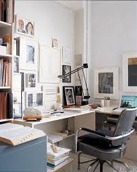 At the New York loft of artist Stephen Antonakos and his wife, art scholar  Naomi Spector, drawings by Antonakos and assorted photographs hang above  the desk ...