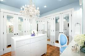 walk thru closet to bathroom a gorgeous chandelier above the island would light your room and