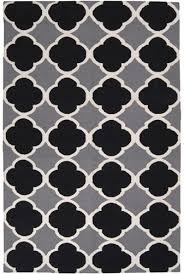 first let s take a look at the rug that inspired my diy outdoor rug project this pattern from zinc door was right up my alley however the 358 tag