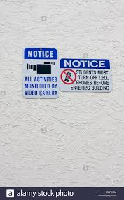 Signs Warning Of Video Monitoring And That Cell Phones Must
