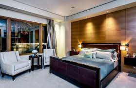 bedrooms contemporary bedroom with small drum shaped wall lamps and grey bed also grey chairs