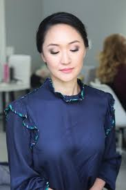 bridal trial a soft glam smoky eye makeup paired with chic elegant chignon