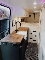 Image Tile Ideas Located In The Center Of The Van The Kitchen Divides The Sleeping Space From The Dwell Best Modern Kitchen Ceramic Tile Floors Design Photos And Ideas