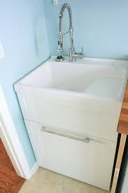 best 25 laundry sinks ideas on small laundry sink laundry room sink cabinet and utility room sinks