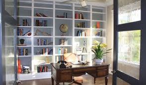 dark wood floors light blue wall white shelving home office traditional office blue home office dark wood