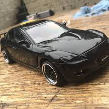 mazda rx8 black modified. interior changed to blackred also converted rh drivelights tinted all round use tinting film rear and side windows front grill painted mazda rx8 black modified 0