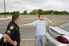 police officer taking sobriety test of man