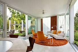orange area rug Living Room Contemporary with beige floor tile