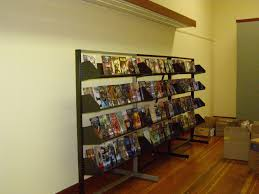 Comic Book Shelving All Things Geeky Two Cats Comic Book Store Sure We're  Open
