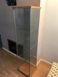 ikea detolf glass door cabinet with wooden base and top 165 cm