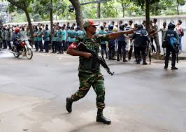 A Security Personnel Reacts Near The Holey Artisan