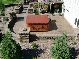 patio with hot tub retaining walls and raised plant beds in west fargo