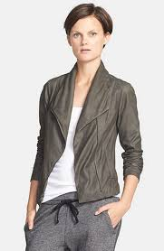 but it has an olive green tone to it it s a gorgeous color the lamb skin leather is very thin and soft so it s a lightweight jacket