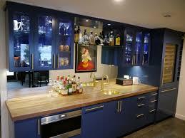 upper cabinet lighting. Blue Painted Shaker Style Bar Cabinets With Lighted Display Upper And Glass Shelves, Floating Bridge Shelf Over Sink, Natural Walnut Cabinet Lighting