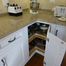 White Kitchen Cabinets With Slate Countertops And Lazy Susan