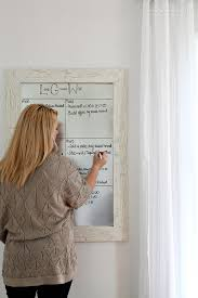 get organized with this diy framed dry erase board it s simple to make and magnetic