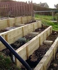 slope raised garden bed on sloped area