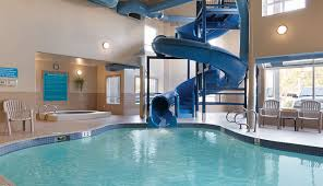 indoor pool with waterslide. Days Inn Red Deer Has An Indoor Swimming Pool, Large Blue Waterslide And A Whirlpool Pool With I