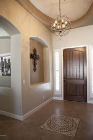 entryway with sandstone tile floors specialty door in chandler pertaining to elegant house foucault orb chandelier