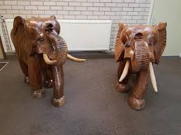 a pair of large rain wood hand carved elephants from india