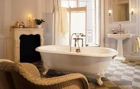 fancy small elegant bathroom design with checd floor with fireplace and rattan chair feat pedestal sink plus clawfoot bathtub