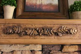 one of the best investments we made in our home was a hand carved wood fireplace mantel this treasured piece with relief sculptures of oak leaves and