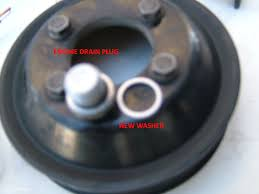 the final step is to remove the actual water pump locate the 4 bolts that hold the composite pulley on the water pump and remove them
