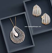 checkout 18k gold designer tanishq diamond pendant paired with matching earrings the pendant has a pearl and with thin chain and matching earrings
