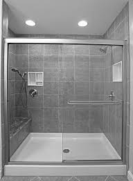 bathroom glass shower room with sliding door connected by stainless steel shower on wall tile